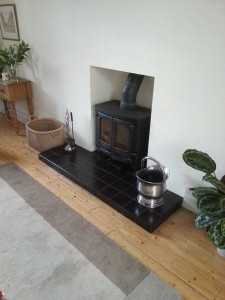 wood burning stove in a fireplace