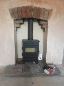 exposed arch above fireplace